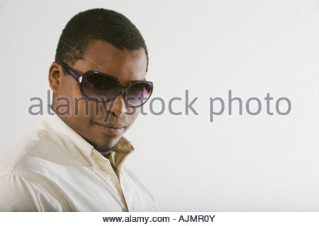 79808de33188 ... Side profile of a mid adult man wearing sunglasses - Stock Photo