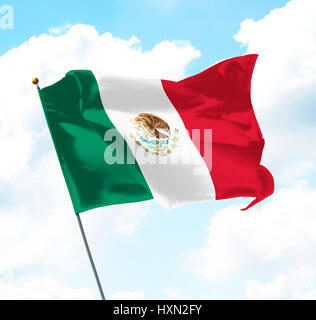 Flag of Mexico flying in the wind against the blue sky Stock
