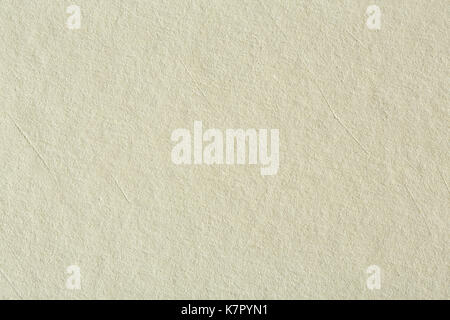 Recycled paper texture background in light cream sepia color