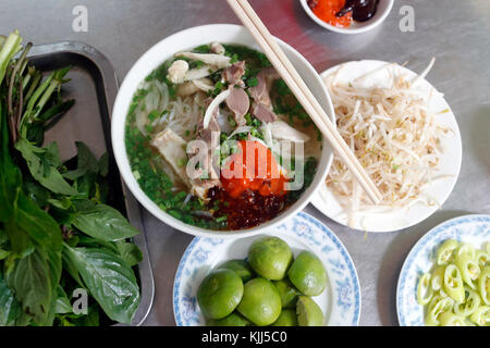 A bowl of Chicken noodle soup or Vietnamese Pho made to a
