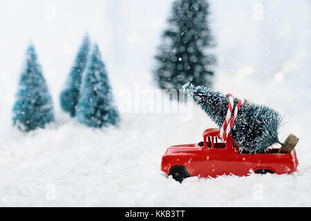 Old Red Truck With Christmas Tree In Back.Old Red Toy Truck With Christmas Tree Loaded On The Back