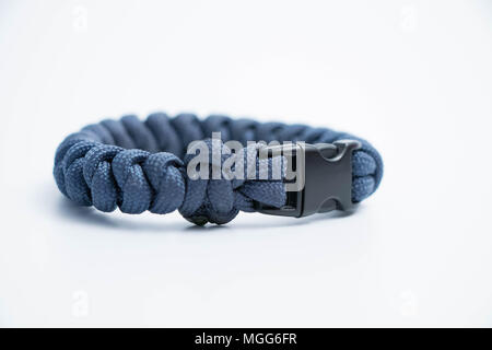 Isolated on white Single survival wristlet bracelet paracord
