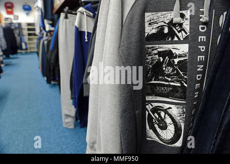 Interior of a small independent mans clothes shop with a