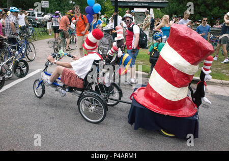 Tour de Fat bicycle parade participant waving while riding