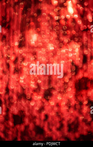 Red colour defocused lights abstract texture background
