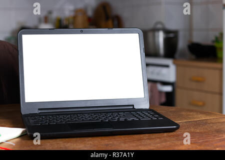 Laptop computer in vintage kitchen  Blank white screen ready for