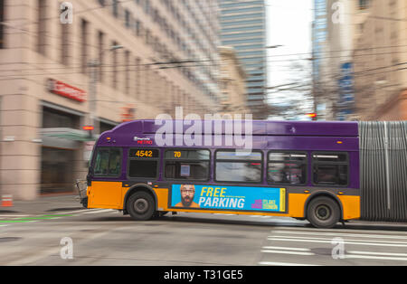 Camera panning of a moving trolley bus in downtown Seattle